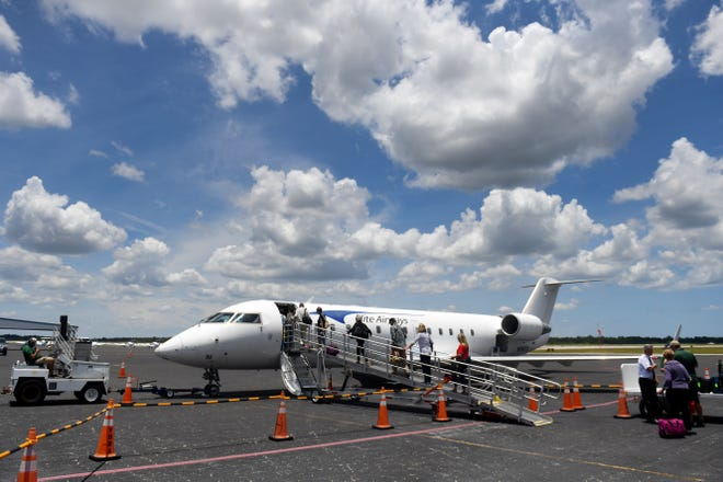 Passengers begin boarding an Elite Airways jet headed for Portland, Maine on Monday, June 3, 2019, on the tarmac at the Vero Beach Regional Airport. The airline currently flies twice weekly to Portland, including flights to Newark, New Jersey and Asheville, North Carolina. Elite is hoping to expand to new cities if the demand from passengers is there.
