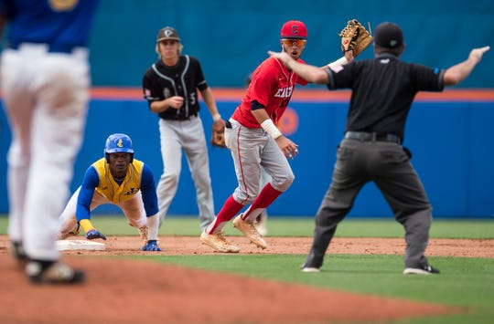 John Carroll Catholic's Dray Sands (left), playing for the North team, successfully steals second base as St. Lucie West Centennial infielder Jorge Gomez (center) looks to the umpire during the third inning of the 12th annual Mike Picano Treasure Coast Senior All-Star Game on Monday, June 3, 2019, at First Data Field in Port St. Lucie. Sands later scored the North's second run on their way to their 2-0 win over the South team.