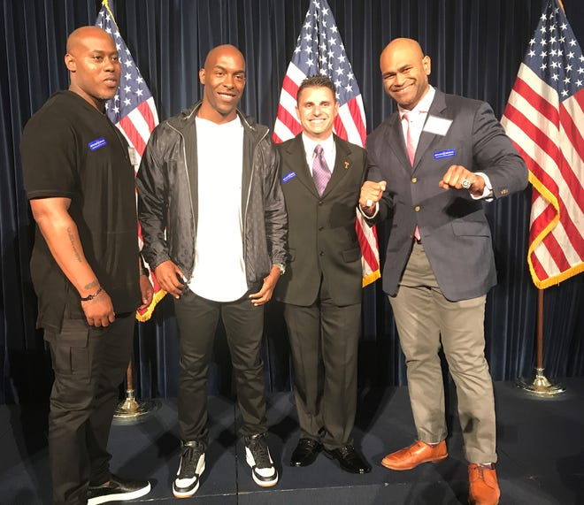 Ronney Jenkins, left to right, Lorenzo Booker, Troy Dumais and Freddy Keaiho pose during Sunday's induction ceremony for the Ventura County Sports Hall of Fame at the Reagan Library in Simi Valley. The four, along with Paul Stankowski (who wasn't present), made up the 2019 class.