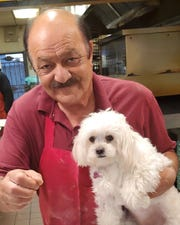 "Abdul ""Freddy"" Majeed is shown with his son's dog. Majeed, who owned Ameci Pizza & Pasta in southwest Oxnard, died Saturday, prompting an outpouring of grief from longtime customers."