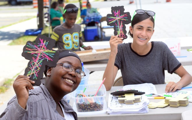 Jeniya Townsend (left), and Marilee Lara, both of Millville, made string crosses during a Playstreets event in Millville last summer. This year's schedule for Playstreets was recently announced.