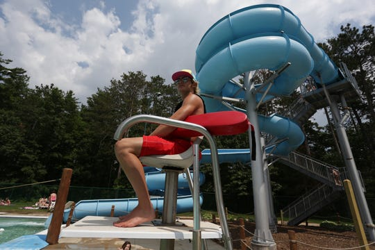 With the water slide in the background, lifeguard Mikey Hubacek watches over the pool at the Rothschild-Schofield Aquatic Center in Rothschild, in this 2013 file photo.