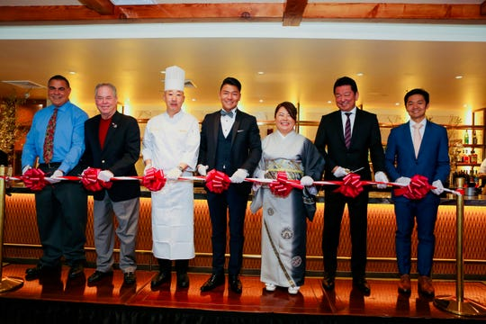The grand opening of Y's Lounge at Mt. Fuji in Hillsdale; left to right: Omar Olayan, Mt Fuji patron; Ed Day, Rockland County Executive, Yoshio Shinohara, executive chef, Mt Fuji; Yoshimasa Tada, owner; Nancy Fujita, 0wner; and Deputy General Manager Hitoshi Hashimoto.
