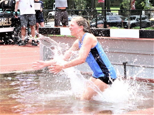 Ursuline's Stella Banino spashes down into water jump during the girls 2019 Eastern States Championships girls steeplechase.
