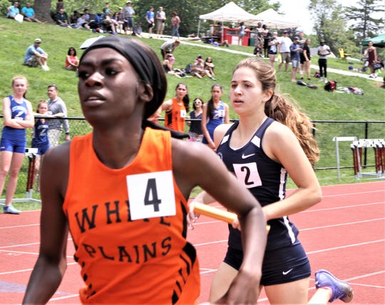Farrah Miller of White Plains heads to finish in 2019 Eastern States sprint medley relay right in front of Rye Country Day's Isabel Stromski.