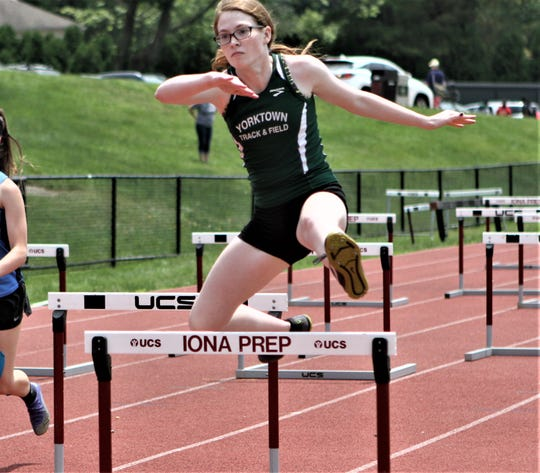 Yorktown's Catherine McClay competes in the shuttle hurdle relay at the 2019 Eastern States Championships at Iona Prep.