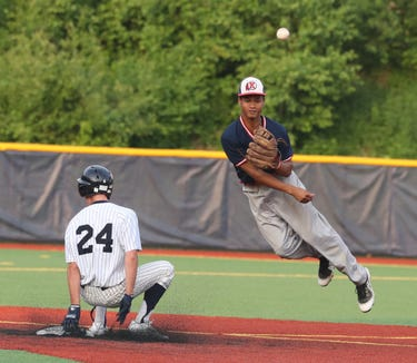 Phoenix Bowman of Ketcham completes a double play after forcing out Kasey Sullivan of Suffern throws in the second inning of the Section 1 Class AA baseball championship game at Pace University June 2, 2019. Suffern defeated Ketcham 6-2.
