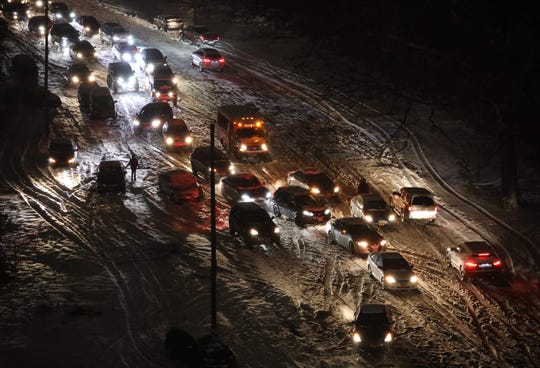 """It's a virtual free for all as evening commuters try to navigate on icy snow covered roads, on the Rumsey Road access road to the Saw Mill River and Cross County Parkways in Yonkers, Nov. 15, 2018.  This photo, """"Stuck,"""" was awarded first place in the Spot News Photo category in the 2018 New York Associated Press Association journalism contest. Awards were announced June 1, 2019."""