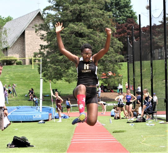 Hackley's Jasmyn Phillips takes to the air during the girls long jump at the 2019 Eastern States Championships at Iona Prep.
