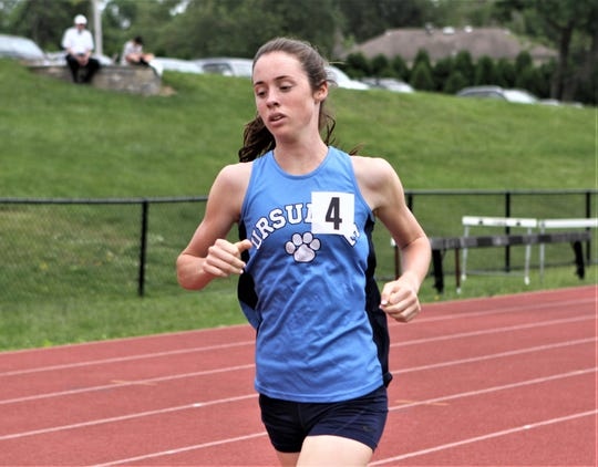 Ursuline's Sarah Flynn runs an outdoor personal-best time in the mile during the 2019 Eastern States Championships at Iona Prep.