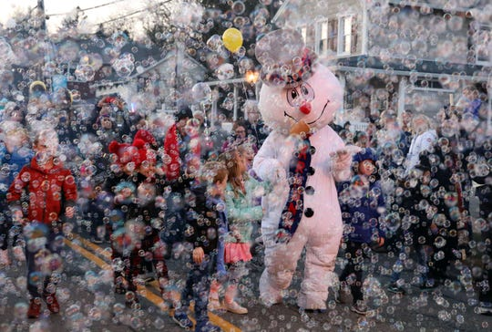 "Frosty the Snowman marches in the 9th annual Frosty Day parade in Armonk Nov. 25, 2018. Steve Nelson wrote the song ""Frosty the Snowman"" in 1953 when he lived in Armonk. The photo was awarded second place in the Feature Photo category in the 2018 New York State Associated Press Association journalism contest in awards announced June 1, 2019."