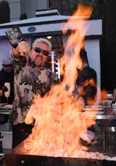 Chef and television personality Guy Fieri prepares food at the Guy Fieri's Vegas Kitchen & Bar booth at Vegas Uncork'd by Bon Appetit Grand Tasting event in Las Vegas on May 10, 2019.
