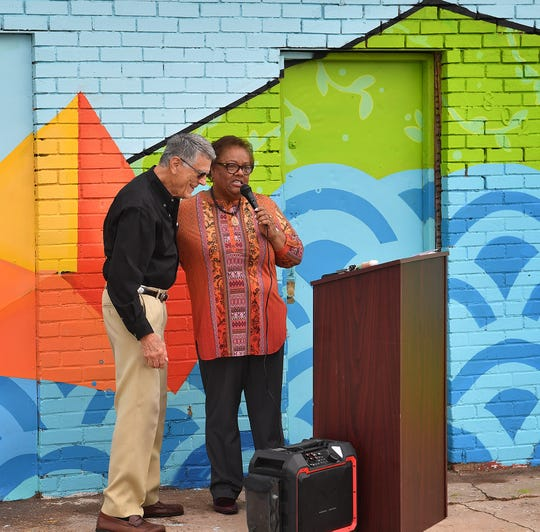 Margie Reese, executive director of the Wichita Falls Alliance for Arts and Culture, thanks philanthropist John Hirschi for helping fund new murals in the community.