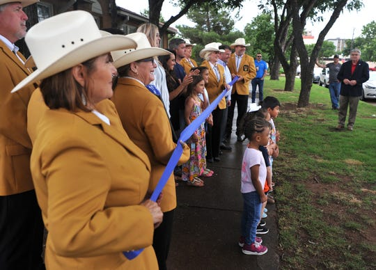 Members from the Wichita Falls Gold Coat Ambassadors and Child Care Partners staff attended a ribbon cutting event held in celebration of  a newly donated sign at the Zale Day Care Center located near downtown on Lamar Street Monday morning.