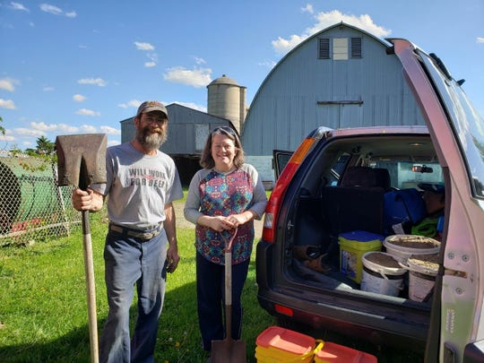 Gary and Elizabeth Moeller happily filled up their buckets on Sunnybook Farm.