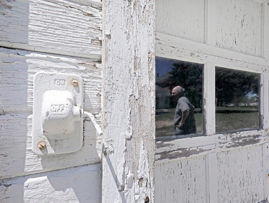 In a Thursday, May 23, 2019 photo, Weathered paint and an old electrical control switch reveal part of the history of a machine shed on the property of the former Thompson-Schneider farmstead in Sun Prairie, Wis. History is now catching up with the home, which is slated to be burned in a series of training exercises by the city's fire department.