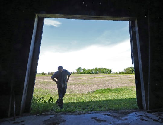 As rapid growth on the west side of the city of Sun Prairie, Wis. continues to change the surrounding landscape, former Mayor Joe Chase surveys the former Thompson-Schneider farmstead Thursday, May 23, 2019. The Civil War-era property, now owned by the city, is also expected to be eventually converted into a yet-to-be-named retailer.