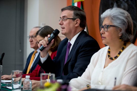 Mexican Foreign Affairs Secretary Marcelo Ebrard, center, speaks at a news conference at the Mexican Embassy in Washington, Monday, June 3, 2019, as a Mexican delegation arrives in Washington for talks following trade tariff threats from the Trump Administration.