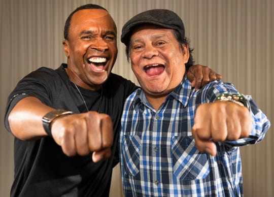 Sugar Ray Leonard, left, and Roberto Duran had three brutal fights but now greet each other with a hug.