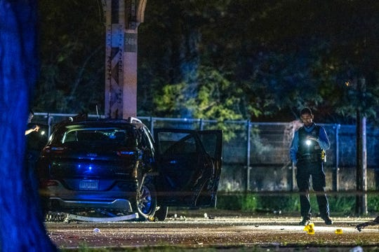 Chicago police investigate the scene where multiple people where shot in the East Garfield Park neighborhood of Chicago on June 2, 2019.