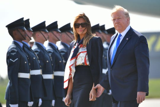 President Donald Trump and first lady Melania Trump walk to the Marine One helicopter after disembarking Air Force One at Stansted Airport, north of London on June 3, 2019, as they begin a three-day State Visit to the UK.