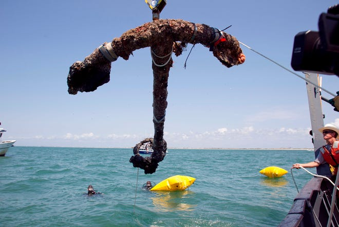 A 3,000-pound anchor from what is believed to be the wreck of the pirate Blackbeard's flagship, the Queen Anne's Revenge, is recovered from the ocean where it has been since 1718 off the coast of Beaufort, N.C.
