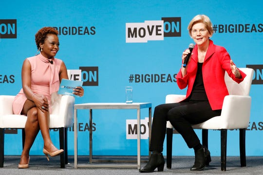 SAN FRANCISCO, CALIFORNIA - JUNE 01: Karine Jean-Pierre and Elizabeth Warren speak onstage at the MoveOn Big Ideas Forum at The Warfield Theatre on June 01, 2019 in San Francisco, California.