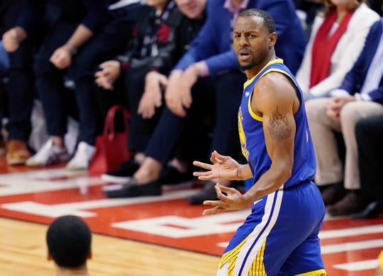Andre Iguodala gestures after making a Three-pointer in opposition to the Raptors.