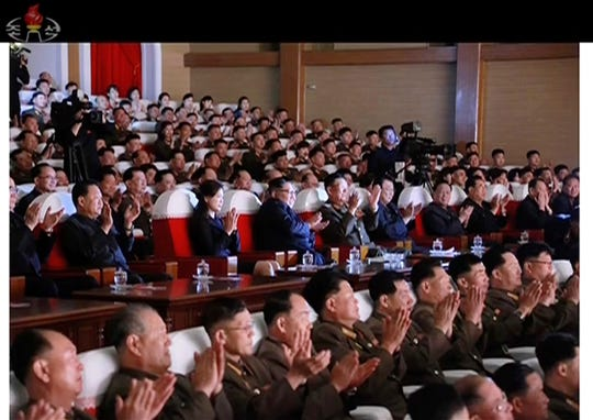 This image made from video of a still image broadcasted Monday, June 3, 2019, by North Korea's KRT shows senior North Korean official Kim Yong Chol, second from right, and a clapping Kim Jong Un, center, sitting in the same row along with other top officials during a musical performance by the wives of Korean People's Army officers Sunday, June 2, 2019. The senior North Korean official who had been reported as purged over the failed nuclear summit with Washington was shown in state media on Monday enjoying a concert near leader Kim.
