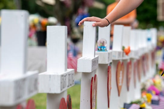 People pay their respects at a memorial for the victims of a mass shooting in Virginia Beach, Virginia, in June 2019.