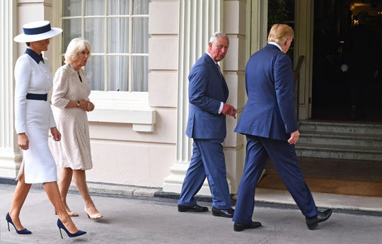 President Donald Trump and first lady Melania Trump walk with their hosts Prince Charles and his wife, Camilla, Duchess of Cornwall, into their London palace, Clarence House, on June 3, 2019, on the first day of the Trumps' three-day State Visit to the UK.