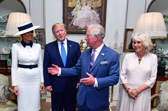 President Donald Trump and first lady Melania Trump pose with their hosts Prince Charles, Prince of Wales, and his wife, Camilla, Duchess of Cornwall, before taking tea at Clarence House in on June 3, 2019, on the first day of the the Trumps' three-day State Visit to the UK.