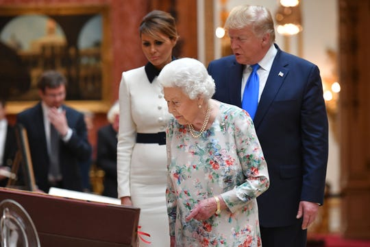 Queen Elizabeth II takes in a display of U.S. items of the Royal collection with President Trump and first lady Melania at Buckingham Palace on June 3, 2019.
