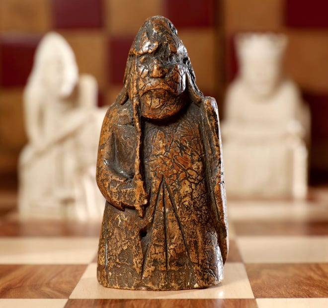 The medieval chess piece purchased for five pounds by an antiques dealer in Scotland in 1964 has been found to be one of the famous medieval Lewis Chessmen. (Tristan Fewings/Sotheby's via AP)