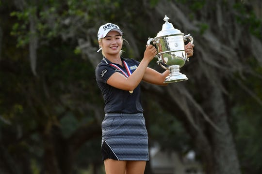 Jeongeun Lee6 holds the trophy after winning the U.S. Women's Open.