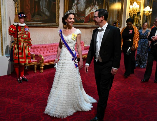 Kate, Duchess of Cambridge and U.S. Treasury Secretary Steven Mnuchin walked into the state banquet through the East Gallery at Buckingham Palace on June 3, 2019. She wore a gown by Alexander McQueen and the Lover's Knot tiara.
