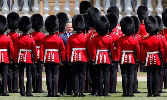 President Donald Trump reviews an honor guard during a ceremonial welcome in the garden of Buckingham Palace in London, Monday, June 3, 2019 on the opening day of a three day state visit to Britain. (AP Photo/Frank Augstein) ORG XMIT: TH130
