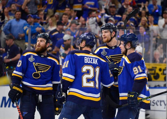 Blues defenseman Colton Parayko (second from right) and his teammates have been inspired by 11-year-old fan Laila Anderson, who suffers from a rare, life-threatening immune disease.