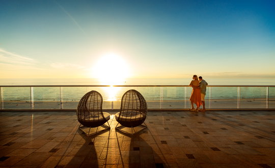 Catch an unforgettable sunset surrounded by azure waters.