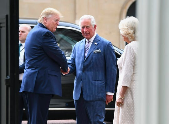 President Trump is greeted by Britain's Prince Charles and Camilla, the Duchess of Cornwall prior to afternoon tea at Clarence House, in London on June 3, 2019.