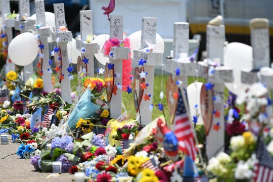 Flowers and mementos left at the memorial at the Municipal Center on June 3, 2019, for the victims of the mass shooting in Virginia Beach, Va.