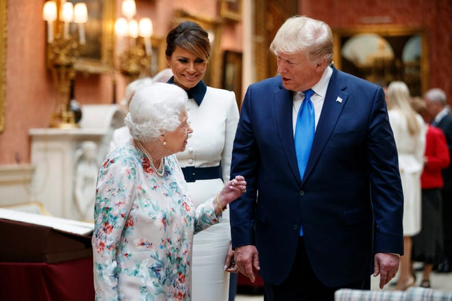 Britain's Queen Elizabeth II speaks to President Trump and first lady Melania as they view U.S memorabilia from the Royal Collection at Buckingham Palace on June 3, 2019.