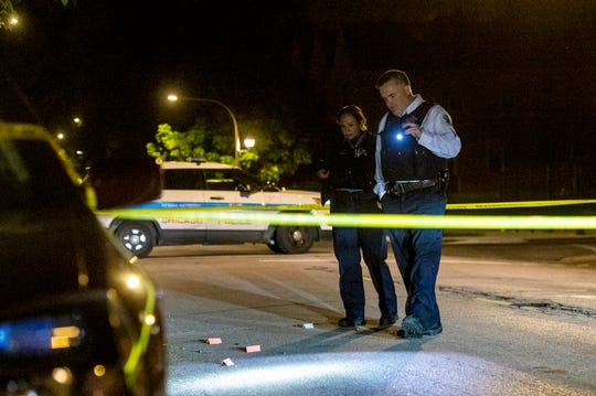 Chicago Police investigate the scene where a man was shot, Monday morning, June 3, 2019, in the Fuller Park neighborhood of Chicago.