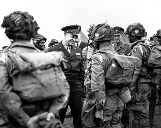 "In this June 6, 1944, file photo, provided by the U.S. Army Signal Corps, General Dwight Eisenhower gives the order of the day, ""Full Victory - Nothing Else"" to paratroopers in England just before they board their planes to participate in the first assault in the invasion of the continent of Europe. June 6, 2019, marks the 75th anniversary of D-Day, the assault that began the liberation of France and Europe from German occupation, leading to the end World War II."