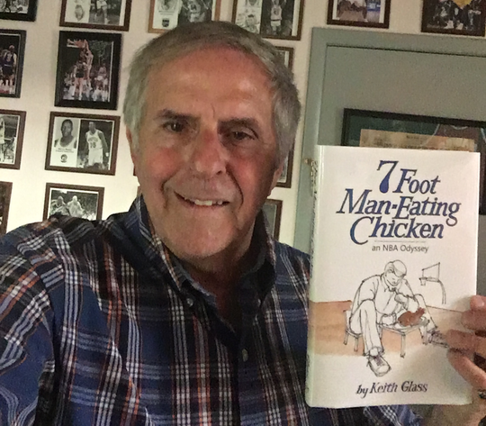 "Keith Glass holds up his new book, ""7 Foot Man-Eating Chicken"""
