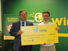 Kristopher Chrysanthopolus, 20, collects his $1 million Mega Millions lottery winnings