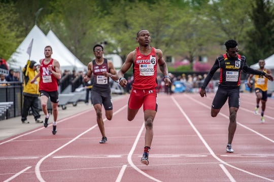 Rutgers' Taj Burgess wins his 400 heat at the Big Ten Championship