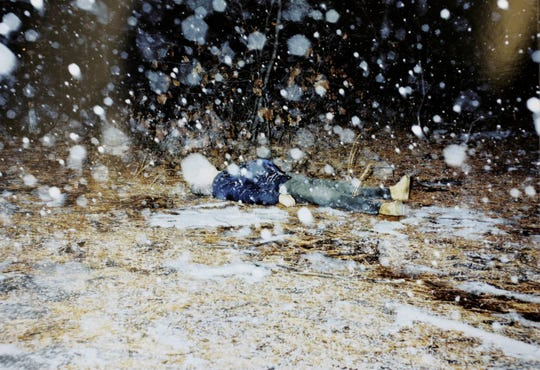 The body of Joseph Hoopengardner is shown in the Lacey Township woods while snow fell around him.