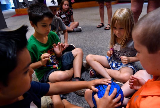 Daniel Henson (lower left) passes a ball to Garrett Monroe as Phoebe Homer and Luke Smith wait for it to come around to them during a game at First Baptist Church Tuesday June 4, 2019. The church kicked off the vacation bible school season with their own program at the beginning of the week.
