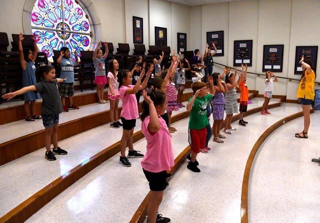 Children dance to a song during vacation Bible school at First Baptist Church on Tuesday.  FBC is one of the first churches in Abilene to launch VBS this year.